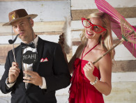man with a cowboy hat, a pipe and a comic ballon, woman with a pink parasol and red big glasses