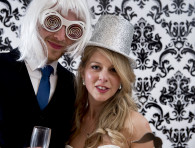 groom with a with wig and funny glasses, bride with a golden hat - wedding photo booth